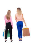 Back view of  two women  with shopping bags Stock Photo