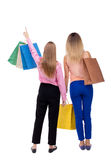 Back view of  two women  with shopping bags Royalty Free Stock Images