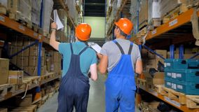 A view on warehouse workers going away. stock footage