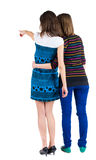 Back view of two young  brunette woman Royalty Free Stock Photos