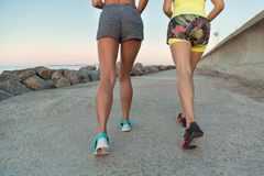 Back view of two young fitness women running Stock Photography