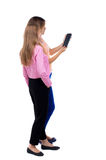 Back view of two young woman look at the smart phone. Royalty Free Stock Photos