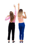 Back view of two young  women dancing. Royalty Free Stock Image