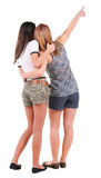 Back view of two young women pointing. Royalty Free Stock Photo