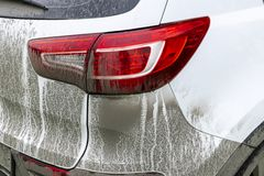 Back view of a very dirty car. Fragment of a dirty SUV. Dirty headlights, wheel and bumper of the off-road car with swamp splashes royalty free stock photo