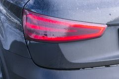 Back view of a very dirty car. Fragment of a dirty SUV. Dirty reBack view of a very dirty car. Fragment of a dirty SUV. Dirty rear. Back view of a very dirty car Royalty Free Stock Photos