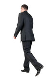Back view of walking  business man. Stock Photos