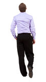 Back view of walking  business man. Stock Image