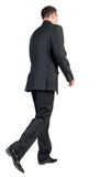 Back view of walking  business man. Royalty Free Stock Images