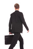 Back view of a walking business man Stock Images