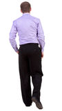 Back view of walking  business man.  going businessman Stock Images