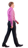 Back view of walking  business man Stock Images