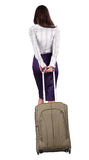 Back view of walking  business woman  with green suitcase. Stock Image
