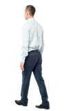 Back view of walking businessman Stock Photo