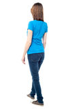 Back view of walking casual woman Stock Photo