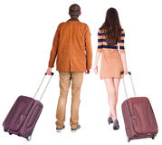 Back view of walking  couple  with suitcase. Pair in motion.  backside view of person.  Rear view people collection. Isolated over white background. Man and Royalty Free Stock Photography