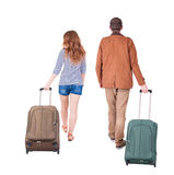 Back view of walking  couple  with suitcase. Royalty Free Stock Images