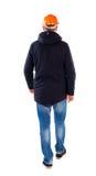 Back view of walking engineer in helmet. Royalty Free Stock Photography