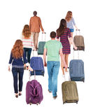 Back view of walking  group with suitcase. Royalty Free Stock Photos