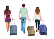 Back view of walking  group with suitcase Stock Photography