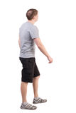 Back view of walking handsome man in sneakers Stock Photo