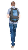 Back view of walking  man  with backpack. Stock Photos