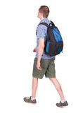 Back view of walking man with backpack. Stock Image