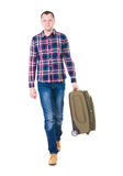Back view of walking  man  with suitcase. Royalty Free Stock Photo