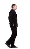 Back view of walking sad businessman Stock Photos