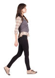 Back view of walking woman . Rear view people collection.  backside view of person. Isolated over white background Stock Photo