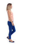 Back view of walking  woman. beautiful blonde girl in motion.  b Stock Photography