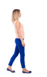 Back view of walking  woman. beautiful blonde girl in motion.  b Stock Images