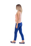 Back view of walking  woman. beautiful blonde girl in motion.  b Royalty Free Stock Images