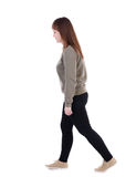 Back view of walking  woman. beautiful blonde girl in motion. Royalty Free Stock Image