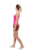 Back view of walking  woman. beautiful blonde girl in motion. Stock Photo