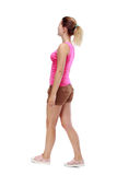 Back view of walking  woman. beautiful blonde girl in motion. Stock Photography
