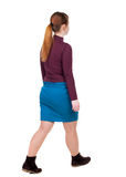 Back view of walking  woman. beautiful blonde girl in motion. Royalty Free Stock Photos