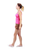 Back view of walking  woman. beautiful blonde girl in motion. Stock Photos