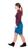 Back view of walking  woman. beautiful blonde girl in motion. Royalty Free Stock Photography