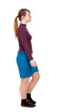 Back view of walking  woman. beautiful blonde girl in motion. Royalty Free Stock Photo