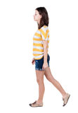 Back view of walking  woman. Royalty Free Stock Images