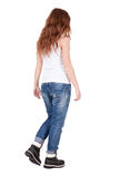Back view of walking  woman . Stock Photography