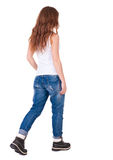 Back view of walking woman . Beautiful redhead girl in motion. backside view of person. Rear view people collection. Isolated over white background. redhead in stock images