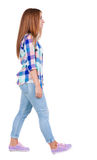 Back view of walking  woman. Royalty Free Stock Photo
