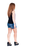 Back view of walking  woman. Royalty Free Stock Photos