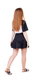 Back view of walking  woman. Royalty Free Stock Image