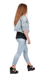 Back view of walking  woman. Stock Image