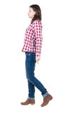 Back view of walking  woman in checkered shirt. Stock Photo