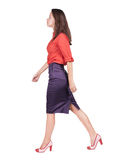 Back view of walking woman in dress . Stock Image