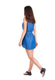 Back view of walking woman . Royalty Free Stock Images